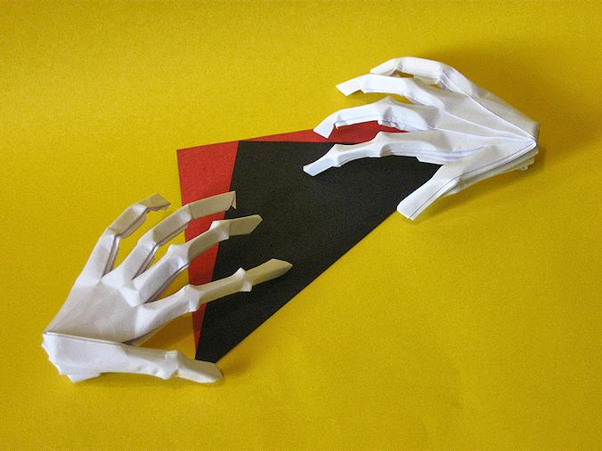 Two Origami Skeleton Hands